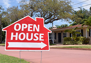 Red Open House sign in a Florida neighborhood